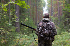 hunter in the forest (aricareynolds) Tags: road autumn people color tree male men sports nature sport horizontal forest season walking outdoors person photography one woods gun image hunting lifestyle scene hobby equipment human camouflage weapon backpack opening shooting leisure hunter shotgun activity rucksack adults pursuit glade hunt recreational russianfederation