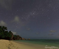Anse Source d'Argent under a starry sky - La Digue Seychelles (lathuy) Tags: ocean africa sunset sea sky mer beach night de stars island islands la soleil grande indian coucher ile boulders national tropical moonlight seychelles plage indien starry source geographic equatorial rochers digue praslin granit anse dargent mah mostbeautifulbeachintheworld lpsleep