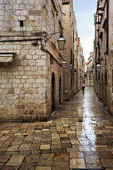 Wet alley at dawn (Hip Hippy) Tags: street old city morning travel light sky cloud house building tower heritage monument wet beautiful rain stone architecture umbrella sunrise square dawn town alley europe mediterranean view outdoor pavement background famous croatia places landmark tourist medieval historic unesco clear paving destination dubrovnik sights adriatic dalmatia