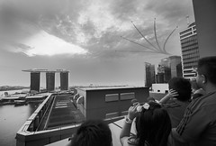Hey, look! (Andrew Tan 2011) Tags: sky blackandwhite bw cloud point evening singapore dusk performance dramatic fast formation binoculars ndp spectators loud starburst mbs vantagepoint f15 marinabay nationaldayparade spped aerialdisplay marinabaysands f15sg ndp2013