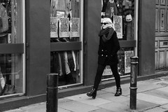 DSC09725 - Blond in high heel boots, wearing sunglasses (roger_thelwell) Tags: life street city uk england urban bw white black streets cold reflection brick london monochrome face hat sunglasses mobile train walking real photography mono high chat phone faces natural boots photos britain candid taxi great hats cell railway shades photographic photographs blond lane cape heel conversation talking spitalfields speak speaking commuters