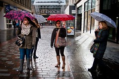 Brolly Squad (Leanne Boulton) Tags: life lighting street city windows winter girls light shadow portrait people urban woman cold color colour reflection brick eye window wet water glass girl face rain weather architecture female scarf umbrella canon shopping bag shower scotland store women colorful shine angle faces boots wind pavement glasgow candid coat centre group wide pedestrian center scene human shade area paving contact colourful shelter raining brolly zone vision:text=0565 vision:outdoor=089