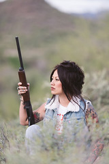 Ashley (Joseph Maddon) Tags: arizona portrait girl tattoo portraits model gun desert fierce modeling rifle az tattoos strong shotgun sonoran bold portraitphotography