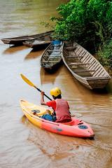 laos-kayaking-kayaker-next-to-wooden-canoes-tiger-trail-06.jpg (Tiger Trail Laos) Tags: travel river southeastasia kayak tour adventure kayaking laos luangprabang tigertrail