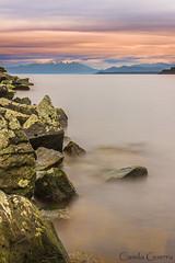 Puerto Varas (Camila M. Guerra) Tags: chile lake southamerica landscape lago volcano stones paisaje paisagem laguna pedras puertovaras vulco amricadosul volcn llanquihue amricadelsur camilaguerra
