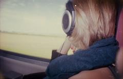 Reiselust (ansehen) Tags: panorama rot analog vintage wagon reisen fenster zug db bahn landschaft mdchen fahren ausblick reise deutsche kopfhrer schnell geschwindigk