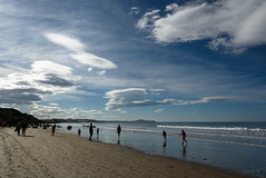 Silhouettes on the Beach (Jocey K) Tags: autumn sea newzealand people beach water clouds reflections sand southisland otago moerakiboulders oamaru moeraki tripdownsouth