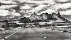 Verdun Road reedited in B&W (ryancurier) Tags: road trip travel blackandwhite mountain monochrome clouds montagne canon landscape 50mm blackwhite view noiretblanc mauritius nuages ilemaurice 450d