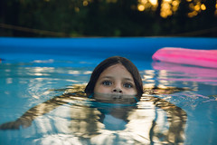 Peeking out of the pool (This_is_JEPhotography) Tags: family trees portrait sky color reflection cute water pool girl field yard swimming outdoors nose eyes pretty bokeh sony niece shallow tamron peeking depth floats slt lense a77 peaking