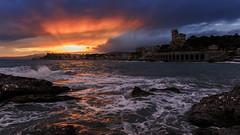 Shades of red (Enrico Cusinatti) Tags: sunset sea sky italy sun mer rocks italia mare genoa genova rays sole rocce scogli enricocusinatti
