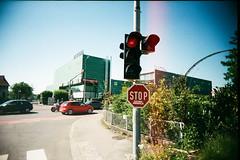 Vegiwerbung. (Markus Moning) Tags: camera light red film animals sign analog 35mm toy austria sterreich fantastic fuji slim traffic eating superia ad wide advertisement plastic stop 200 fujifilm veggie werbung viv vivitar ultra ampel vegi lauterach vorarlberg vegetarier at expred achpark