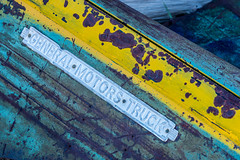 Bodie - General Motors Truck (www.karltonhuberphotography.com) Tags: california abstract history texture lines yellow colorful parts patterns exploring details adventure hood bodie discarded relic easternsierra historicsite 2016 truckhood karltonhuber gmbadge generalmotortruck