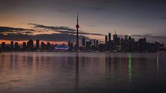 Toronto Sunset (Torsten Reimer) Tags: ca longexposure sunset sky toronto ontario canada water skyline clouds reflections wasser sonnenuntergang cntower skyscrapers searstower himmel wolken northamerica lakeontario wolkenkratzer langzeitbelichtung torontoharbour reflektionen rogerscentre