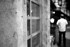 On a Saturday evening (Nikon FM3A) (stefankamert) Tags: stefankamert blurred grain noir noiretblanc nikon fm3a fm baw bw sw ilford hp5 film analog 35mm blackwhite blackandwhite schwarzweis sca epson v550