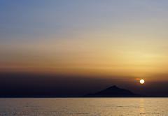 Hazy Sun begins to set behind Mount Athos (view from Myrina Town - Lemnos) Olympus OMD EM5II (markdbaynham) Tags: island greek north aegean hellas evil olympus greece grecia gr zuiko omd csc oly mz limnos hellenic m43 zd mft lemnos myrina mirrorless micro43 mzuiko m43rd em5ii zuikolic