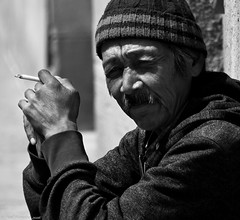 Canada's 'invisible' Hispanic community (Neil. Moralee) Tags: street old shadow portrait people blackandwhite bw sunlight white man black eye monochrome face hat sunshine french mono hands nikon alone close quebec outdoor cigarette candid smoke pipe neil cigar canadian smoking mexican mature stare contact deprived smoker beanie staring francophone beany d7100 moralee neilmoralee canadaneilmoraleenikond7100 hispanit