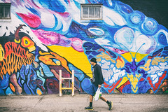 Mural Artwork X Pedestrian (IQRemix) Tags: urban canada building art wall graffiti artwork alley mural colorful downtown colours edmonton candid pedestrian alberta innercity brickbuilding urbanlife yeg yegdt