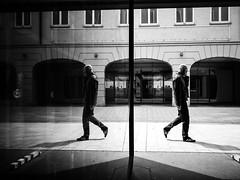 live your style (Sandy...J) Tags: street city shadow urban bw white man black reflection silhouette germany walking bayern deutschland photography mono blackwhite fotografie walk streetphotography olympus stadt sw mann monochrom spiegelung bavarian gehen spazieren schwarzweis strase strasenfotografie
