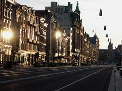 Amsterdam City (Andreas Roth123) Tags: life street city morning light holland beautiful lines amsterdam bicycle sunrise gold central cityscapes bikes tram olympus scooters em10