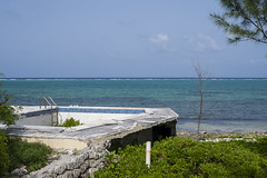 Reclamation (-j-o-s-e-) Tags: flowers blue trees red storm building tree abandoned beach water coral rock pine sand rocks aqua empty hurricane ivan shoreline roots carribean grand east shore tropical waters cayman shallow wreck damaged reef volcanic derelict tropics eastend