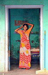 Framed (Pharheen) Tags: street red portrait people orange woman india smile rural alone village solo saree