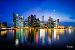 Azure (LINYIHAN) Tags: city blue sky panorama moon reflection skyline architecture night marina buildings river dark lights evening bay singapore glow cityscape angle dusk district central wide filter lee hour fujifilm cbd financial hdr finance 1024 gnd xt1 3stops xf1024mm