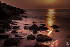 Reflection, (Tristan Roebersen) Tags: tristan roebersen troebersen sun evening late flow long exposure nd filter reflection beach sea stones green water waters beaches stone sand mos red yellow glow 4 seconds epic cool landscape hip nice dips awesome view sunset