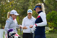 Hannah Burke, Marianne Skarpnord and Nicole Broch Larsen check their ball numbers on the first tee during the third round (Ladies European Tour) Tags: morocco mor rabat burkehannaheng skarpnordmariannenor brochlarsennicoleden