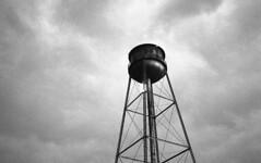 Water Tower in Stormy Skies (bclook) Tags: bw film analog noiretblanc d76 ilfordhp5 schwarzweiss selfprocessed leicam6 filmisnotdead summicron502 istillshootfilm bwfp