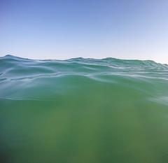 Summer Afternoon (L.Grey Photography) Tags: ocean blue sea summer sky sun beach nature water nc sand waves outdoor north scenic ilm fisheye carolina wilmington wrightsville crashing seafoam gopro goprohero4