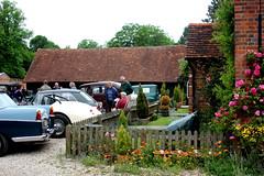 Cottages and Cars (EastMarple1) Tags: flowers roof woman dog man brick car rose barn vintage tile deckchair village cottage fete berkshire yattendon
