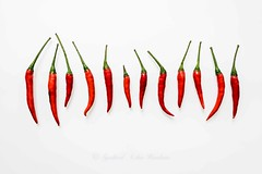 Red chillies (Syahrel Azha Hashim) Tags: light food hot detail colors 35mm prime colorful dof market herbs sony details naturallight selection nopeople fresh whitebackground negativespace spices malaysia ingredients handheld spicy shallow variety minimalism choices simple groceries arrangement assortment chillies a7ii colorimage redchillies sonya7 syahrel ilce7m2