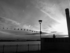 the yogi (vfrgk) Tags: sunset sky blackandwhite bw girl monochrome ship view riverside cloudy relaxing streetphotography peaceful tranquility streetlife streetscene serenity urbanmoment serene relaxation enjoying urbanlife