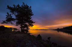 Norwegian archipelago II (Explored) (Bangern) Tags: longexposure light sea sky seascape color tree nature silhouette norway night clouds nikon horizon illumination le citylights saturation archipelago d800 hurum 14mm samyang skjttelvik