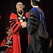 Chancellor Randy Woodson (left) congratulates a graduate after receiving his degree.