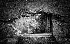 a hole in time (Lostboy Photography) Tags: blackandwhite concrete graffiti hole gray railing tairs
