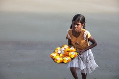 Flower girl (Dick Verton) Tags: travel flowers india girl walking asia varanasi flowergirl selling ganges ghats dickverton {vision}:{outdoor}=0803 {vision}:{sky}=0763 {vision}:{mountain}=0525