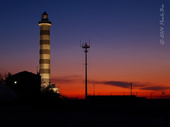 L'alba al faro ... (PaoloBis) Tags: ocean morning sea lighthouse beach sunrise faro lights sand mare awakening alba getty luci spiaggia gettyimages sabbia mattino jesolo risveglio paolobis