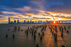 The Other Skyline - New Jersey (Strykapose) Tags: new sunset reflection tower clock clouds river pier big waterfront place perspective shift filter newport lee nd jersey hudson colgate hook pylons tilt goldman exchange stopper sachs correction paulus tiltshift colgateclock paulushook harsimuscove goldmansachstower downtownjerseycity tse24mmf35lii leebigstopper canon5d3