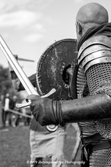 [2014-04-19@11.10.39a] (Untempered Photography) Tags: history monochrome costume fight medieval tournament weapon sword knight shield combat armour reenactment skirmish combatant chainmail canonef50mmf14 perioddress platearmour mailarmour untemperedeye canoneos5dmkiii untemperedeyephotography glastonburymedievalfayre2014