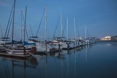 Pier 39 Boats (dannyloera) Tags: boats sundet lowlight sf sanfrancisco pier39 pier reflection water blue bridge light ocean