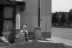 Canon Prima Zoom (Sure Shot) 76AiAF - Woman at Bus Stop (Kojotisko) Tags: bw streetphotography brno creativecommons czechrepublic streetphoto rodinal fomapan100 canonprimazoom76aiaf