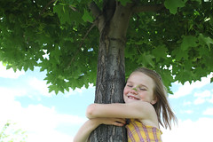 BP1H7A (SafeLives photo library) Tags: trees summer brown tree green love nature girl smile leaves childhood hair for maple hugging happiness pollution environment awareness displaying embracing