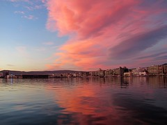 A city between the colorful clouds. (kostakai) Tags: city sea seascape clouds greece volos