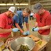 BBQ Camper attendees prep fire roasted peppers for dinner.
