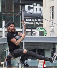 Busker in Dundas Square (jer1961) Tags: toronto streetperformer acrobat busker dundassquare poleclimber