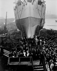 Launch of the Japanese cruiser 'Iwate' (Tyne & Wear Archives & Museums) Tags: chimney people abstract blur building industry public water japan stairs interesting construction industrial ship unitedkingdom crane timber crowd decoration platform bank rail vessel rope structure deck soil cap crew transportation frame porthole gathering iwate archives land barrier products unusual hook launch shipyard naval plank tyneside development cruiser launchparty impressive warship newcastleupontyne fascinating digitalimage factories customers rivertyne manufacturing industrialheritage elswick northeastengland blackandwhitephotograph scotswood shipbuildingheritage maritimeheritage imperialjapanesenavy lordarmstrong vickersarmstrong elswickworks williamgeorgearmstrong workshopoftheworld scotswoodworks 29march1900 japanesecruiser vickersarmstrongcollection elswickshipyard