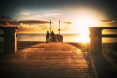Spatsommer (dubdream) Tags: ostermade people beach ocean balticsea sea pier sunrise autumn railing cloud colorimage cloudysky calmsea longexposure shadow schleswigholstein germany dubdream nikon d800