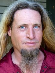 Celtic Fest Vendor (J Wells S) Tags: ohio portrait hair goatee eyes blueeyes waynesville candidportrait piercingeyes ohiorenaissancefestival harveysburg celticfestohio celticfestvendor