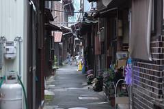 going home (k n u l p) Tags: street lake girl rain sisters alley village sony shiga biwa   okishima  1670mm  nex7 sel1670z